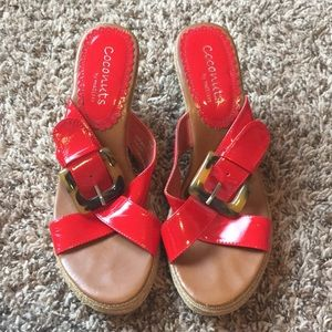 Size 9 red and tan strapped wedges with buckle.